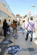 A group of EV artists helping install the portraits of Syrian children for the final exhibition.