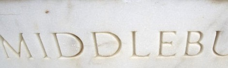 photo of Middlebury College sign in marble