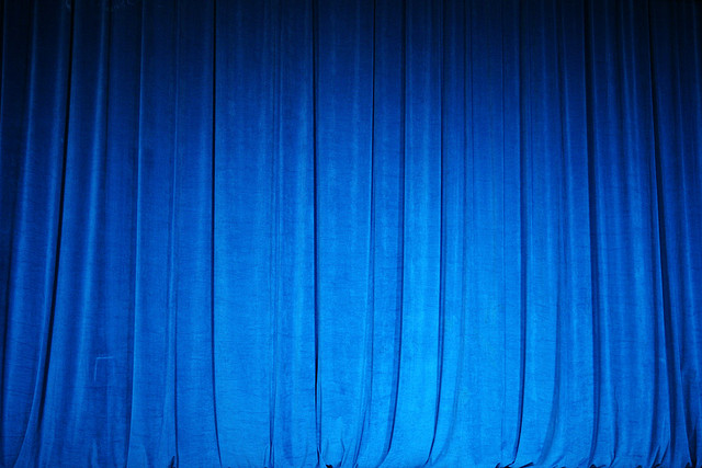 Photograph of blue velvet theatre curtain.