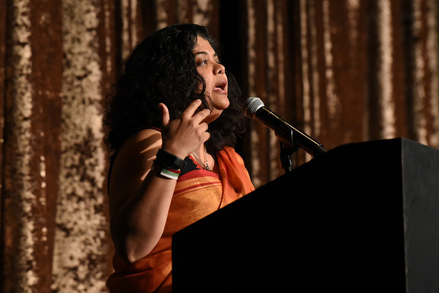 Anasuya Sengupta speaking at a podium