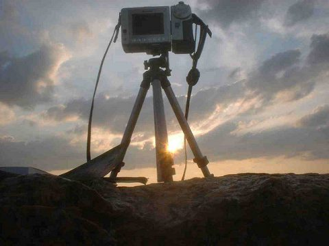 camera and sunrise by Ted Gresham on Flickr at https://flic.kr/p/o2v6By