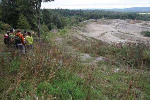 Standing on the edge of the quarry near Battell Research Forest