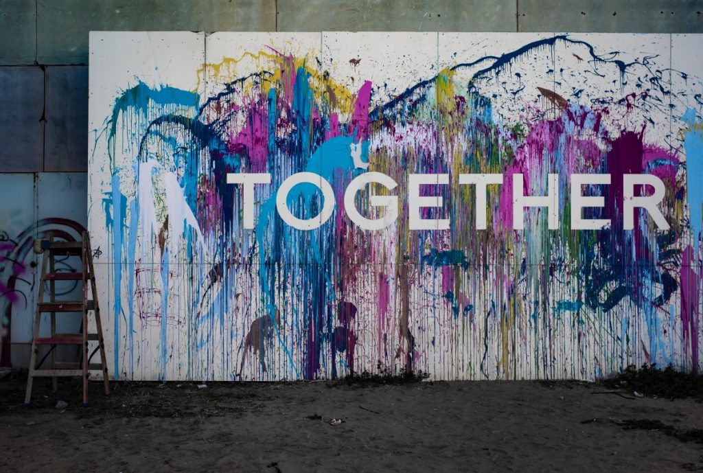 Picture of painted wall with the word 'together' on it