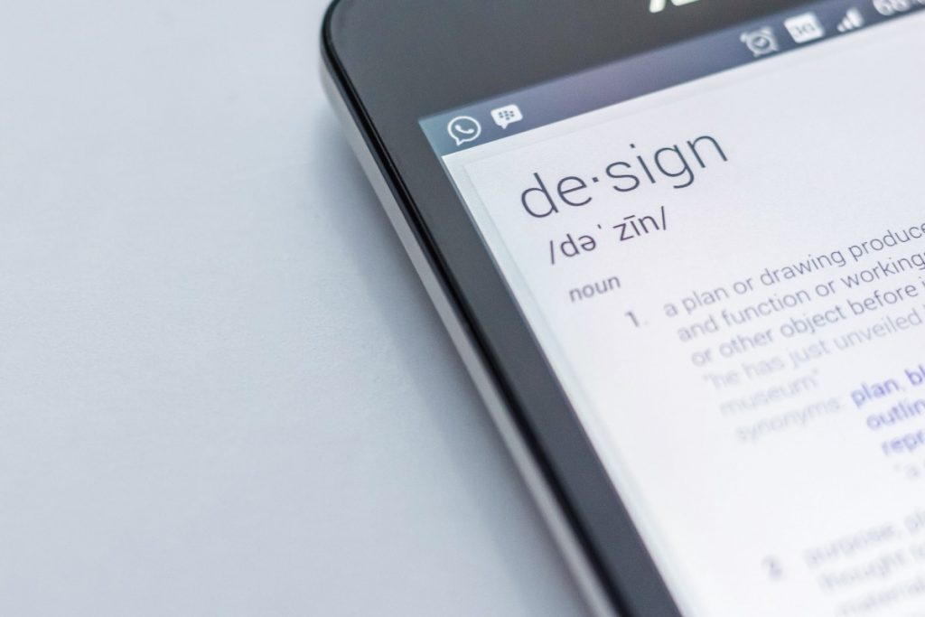 "A picture of a smartphone with the word ""Design"" on it with a definition."