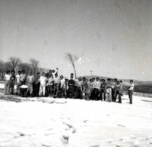 The 1975 lacrosse team shovels snow off the field. The team went on to become Middlebury's first ECAC Lacrosse Champions