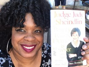 Katrina Spencer poses with a book
