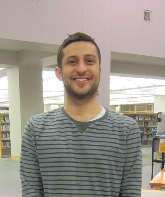 Photograph of circulation student assistant Jason Meuse standing in Davis Family Library