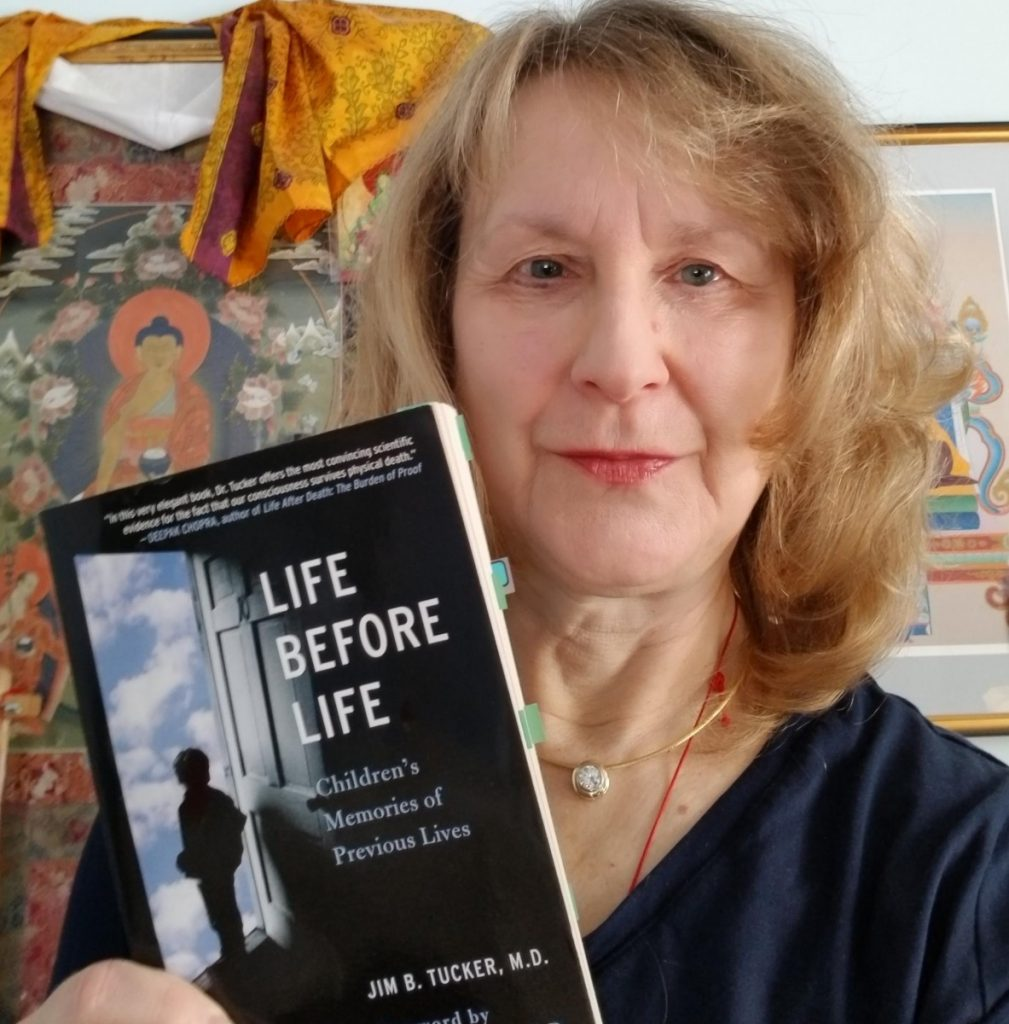 a woman posing with a book