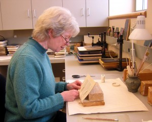 Ginny Faust in the Conservation Workroom.