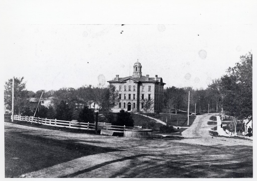 The Academy Building in 1900 seen from the corner of South Main St. and Cross St.