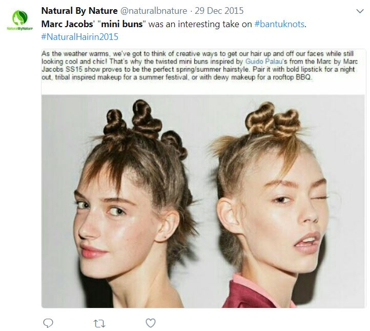 Two white women modeling Bantu knots