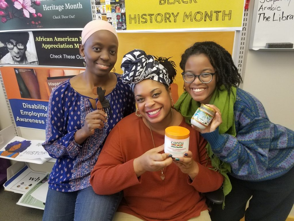 three women holding products