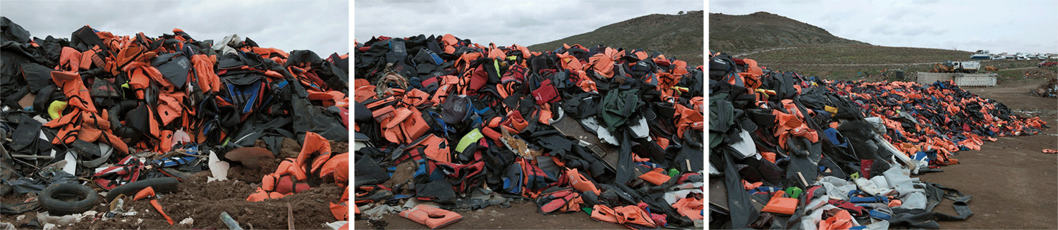 an endless pile of refugee life jackets on Molyvos, Lesbos, Greece