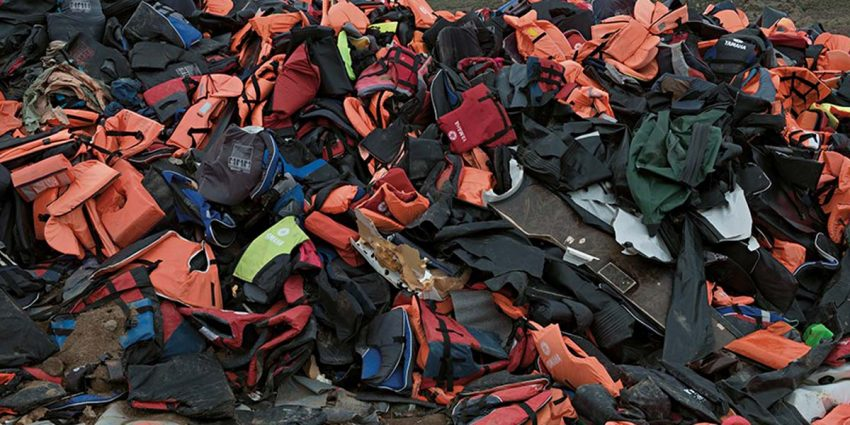 detail of photograph showing piles of discarded life preservers