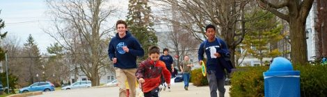 Mentors and mentees run along a sidewalk together