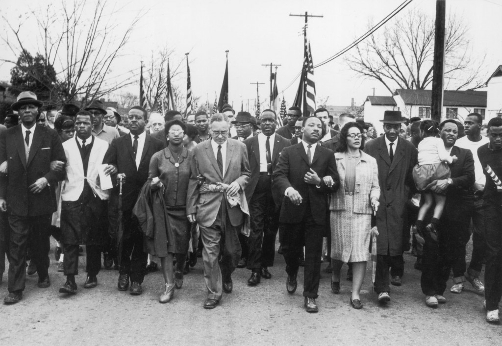Arm in arm, Martin Luther King, Jr., and his wife, Coretta Scott King (in light-coloured suit), leading the voting rights march from Selma to Montgomery, Alabama, March 1965.