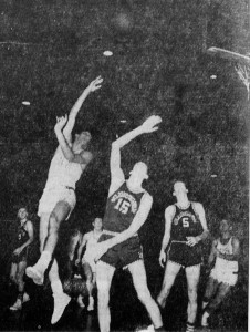 Playing in the final game of his career, Sykes attempts a hook shot over a St. Michael's defender.