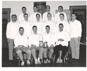 Sykes (bottom row, far right) worked as a waiter in the Gifford Dining Hall with teammates Zip Rausa and Jim Wagner (also pictured).