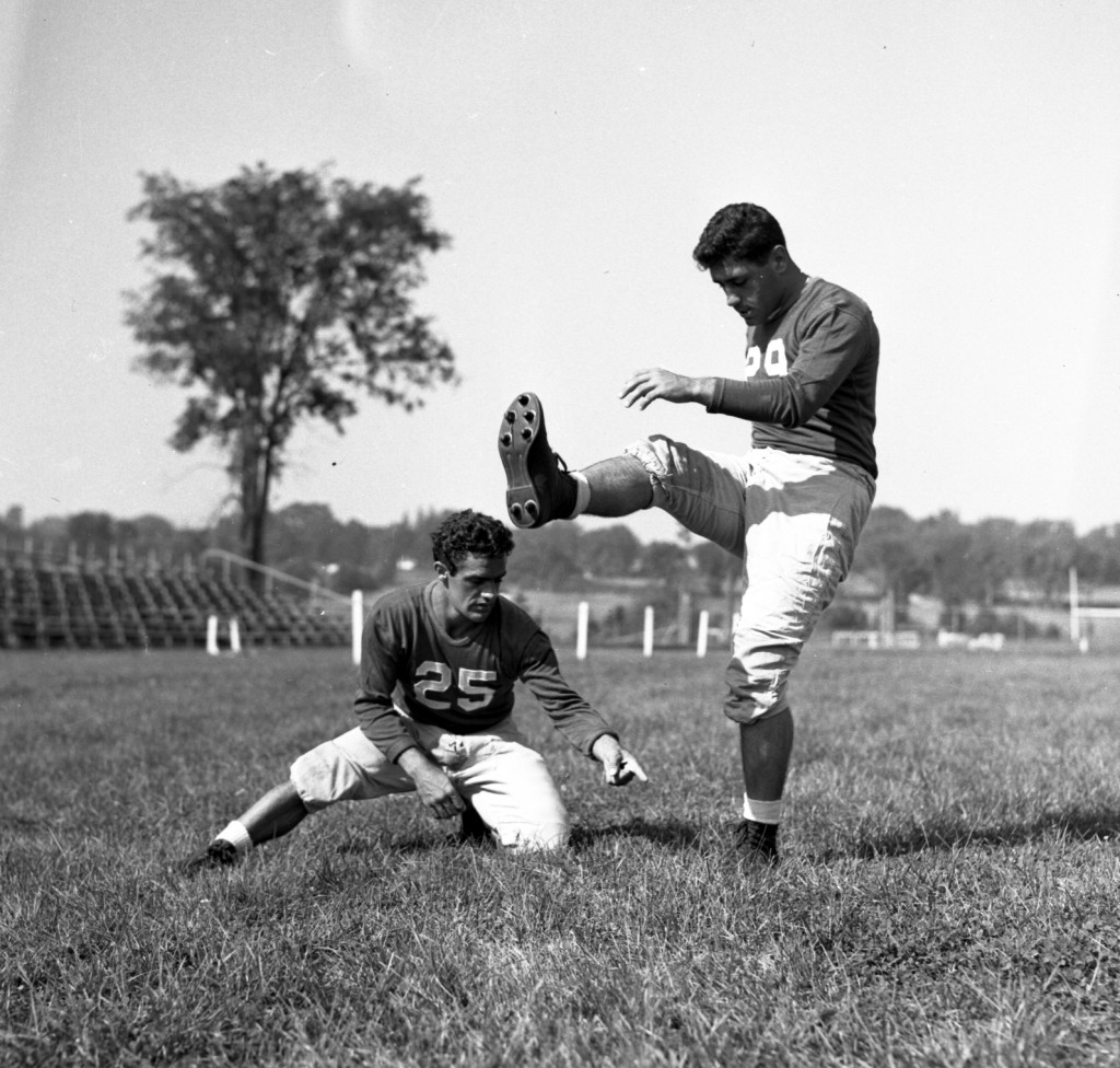 Two players from the 1947 lineup practice the skills that won them the state championship.