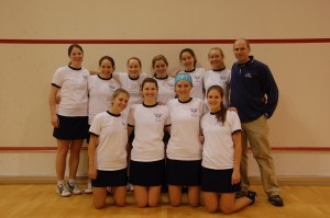 The women's squash team with the new coach, Mike Morgan. He only coached for one season.