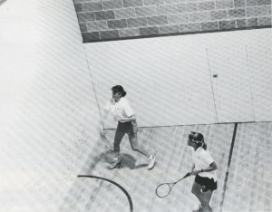 Two of the 1986 team members in action in the Fletcher Field House American-style squash courts.
