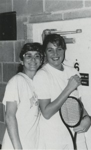 Two team members pose outside of a squash court in Fletcher Field House. (Kaleidoscope, 1989, page 156)