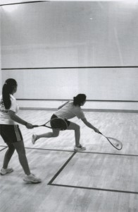 Two players in action on the new courts International style courts in the Bubble (Kaleidoscope 2003, page 131)
