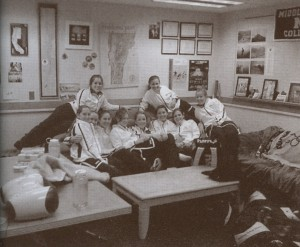 The women's squash team all together in Coach John Illig's office. Photo taken from the 2009 Kaleidoscope.