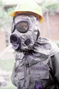 A member of the United States army in biohazard gear  http://upload.wikimedia.org/wikipedia/commons/1/1e/NBC-Mask_M-17.jpg