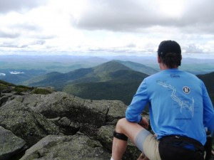 A trailrunner enjoys the summit views
